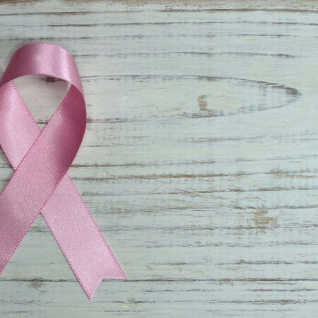Pink Ribbon On Wood